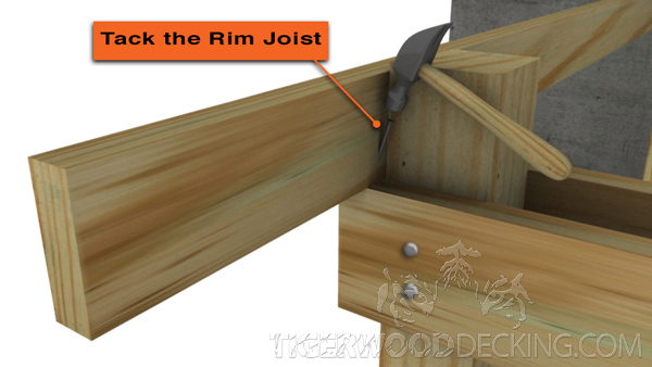Use a nail to temporary attach the rim joist to the beam. This will NOT be the final fastener used in installation.
