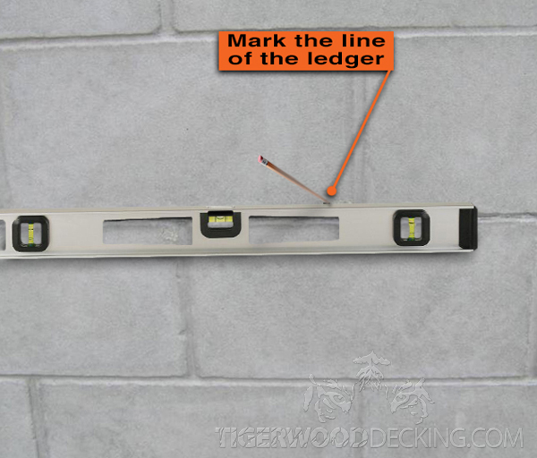 Draw a line so you know exactly where the ledger will be placed.